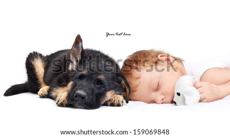Sleeping Baby Boy with toy dog and puppy. - stock photo