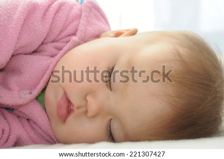 Sleeping baby girl in pink dress portrait, baby care for healthy life