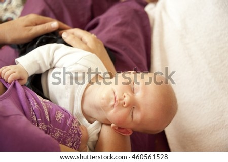Sleeping baby held in arms