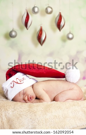 Sleeping baby santa - stock photo