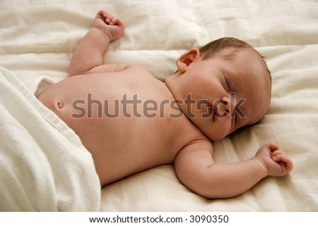 Sleeping Baby with Arms Outstretched