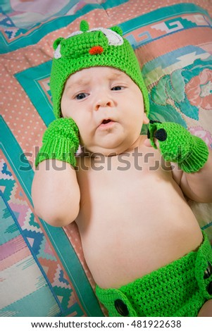 Sleeping baby with knitted hat. Baby boy, sleeping. baby sleeps in an embrace with a toy