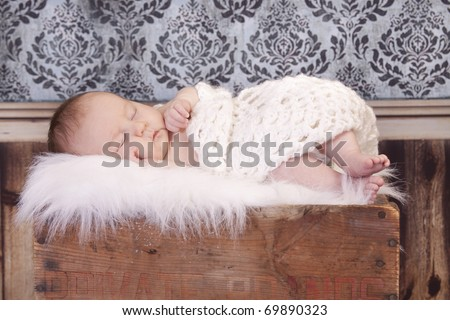 Sleeping baby with vintage background - stock photo
