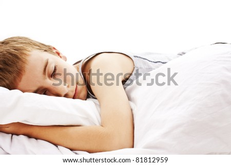 Sleeping boy in bed , isolated on white. - stock photo