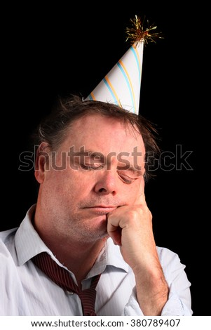 Sleeping Business Man in a Party Hat