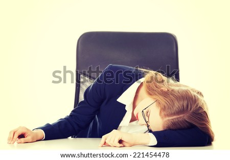Sleeping business woman by the table. Isolated on white. - stock photo