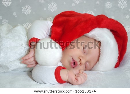 Sleeping christmas newborn baby in  Santa Claus red hat. Photo for calendar, card  - stock photo