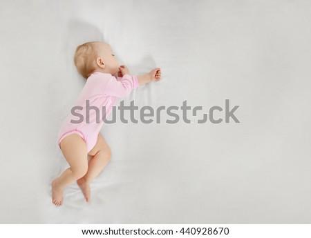 Sleeping cute baby - stock photo