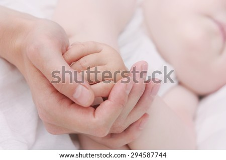 sleeping cute baby, maternity concept, soft image of beautiful family