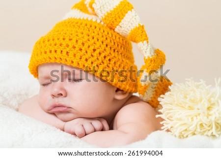 Sleeping. Cute newborn baby sleeps in a hat - stock photo