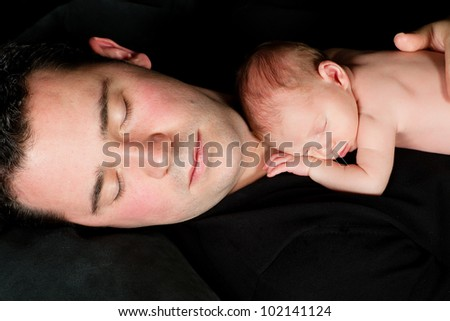 Sleeping father with his 18 days old baby