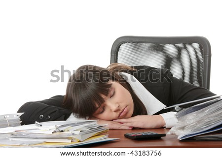 Sleeping female filling out tax forms while sitting at her desk. Isolated - stock photo
