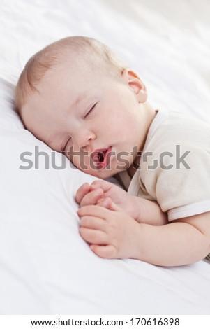 sleeping  funny baby boy on a white background - stock photo
