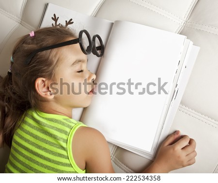 Sleeping girl lying in the glasses on the open book with empty pages - stock photo