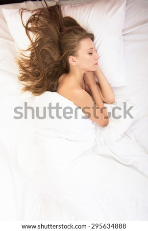Sleeping girl, view from above - stock photo