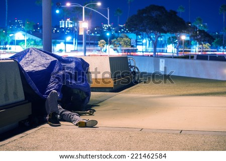 Sleeping Homeless Men in California, United States.  - stock photo