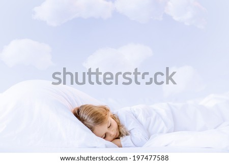 Sleeping in bed little girl - stock photo