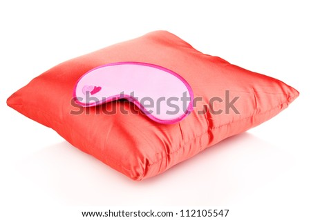 Sleeping mask on pillow isolated on white