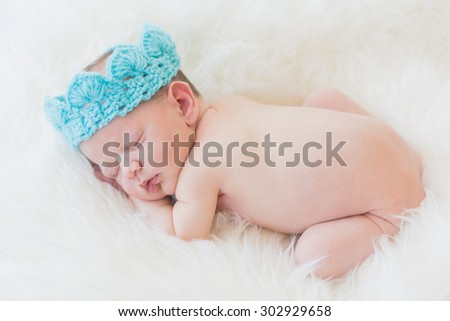 Sleeping newborn baby boy - stock photo