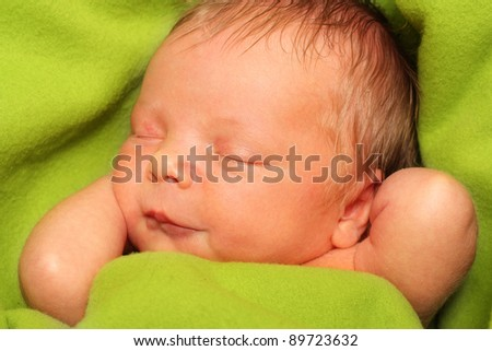 Sleeping Newborn Baby Boy in a Green Blanket - stock photo