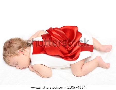 Sleeping newborn baby boy with red bow - stock photo
