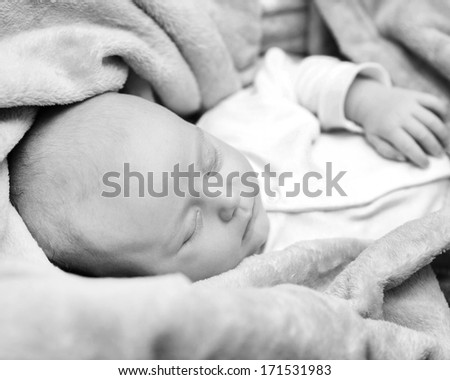 sleeping newborn baby closeup in black and white