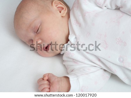 Sleeping newborn baby girl. - stock photo