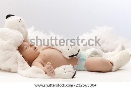 Sleeping newborn baby with big bear hat. - stock photo