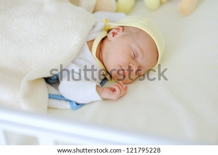 Sleeping newborn girl. 3 weeks old
