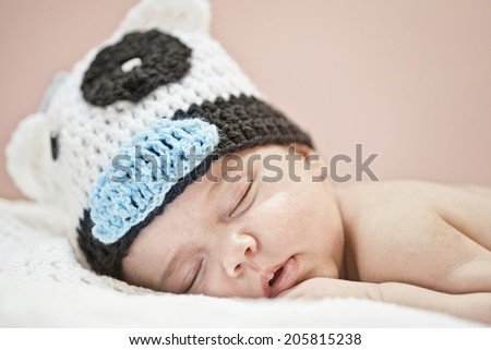 Sleeping newborn over delicate pink background, closeup - stock photo