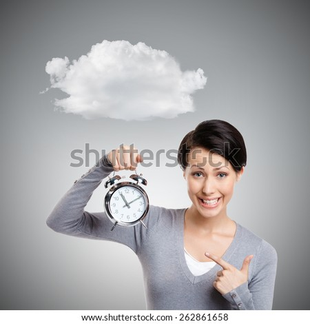 Sleeping pretty woman holds an alarm clock, isolated on grey background - stock photo