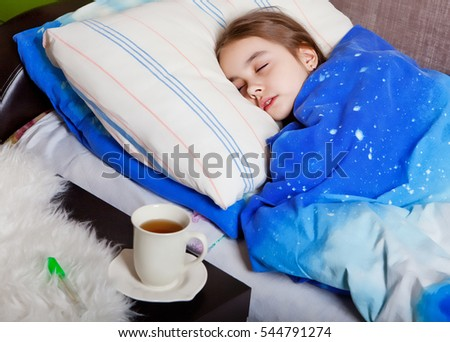 Sleeping sick child home in bed