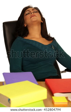 sleeping tired businesswoman with computer and Books - stock photo