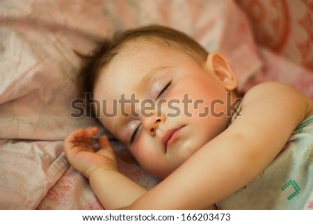 Sleeping tot,small boy,breast child,Shallow DOF