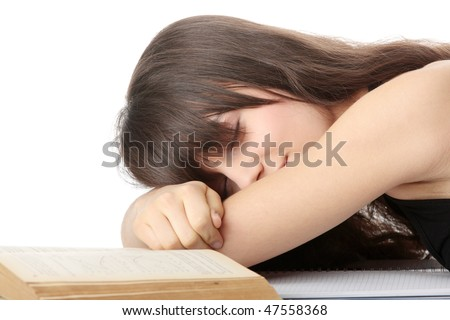 Sleeping while learning - tired teen woman sleeping on desk, over white background - stock photo