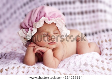 Sleeping with hands in an adorable pose - stock photo