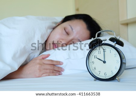 Sleeping Woman and alarm clock