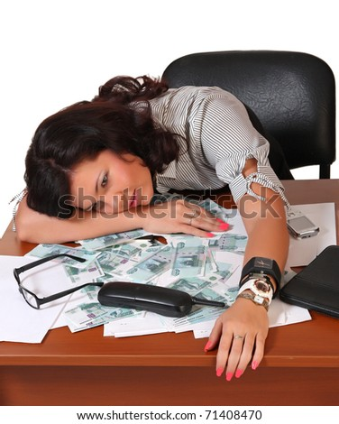 Sleeping woman at work and money - stock photo