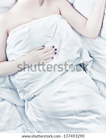 sleeping  woman figure  in bed  overhead view photo - stock photo