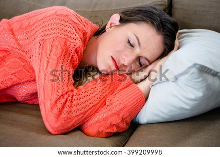 sleeping woman taking a nap on the couch - stock photo