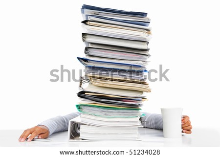 Sleeping worker behind high pile of paperwork, isolated in white background - stock photo