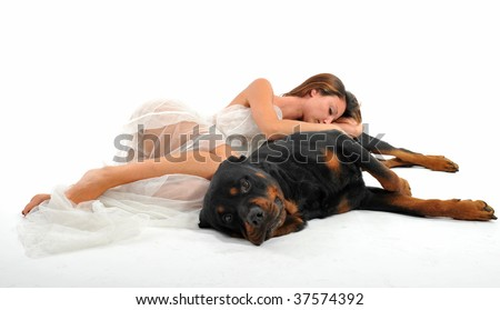 sleeping young bride and her purebred rottweiler