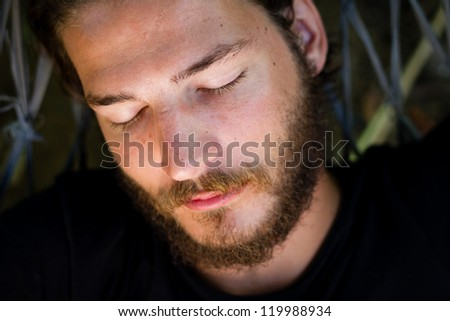 sleeping young man - stock photo