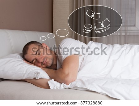 Sleeping young man and dreaming about money - stock photo