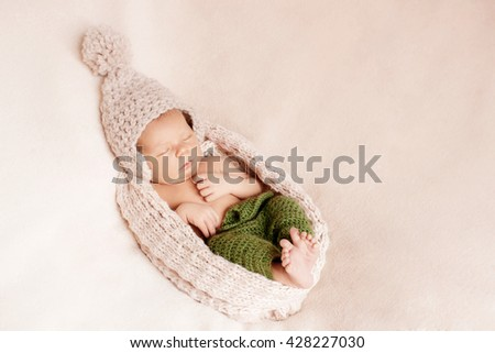 Sleepy baby in a cocoon - stock photo