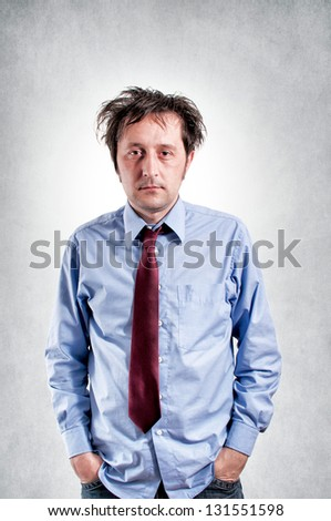 Sleepy businessman on gray background - stock photo