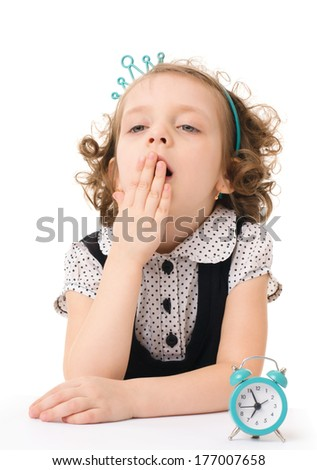 Sleepy little girl with wake up, isolated on white background - stock photo