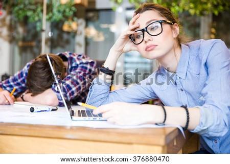 Sleepy overworked business people sitting and sleeping in meeting room  - stock photo