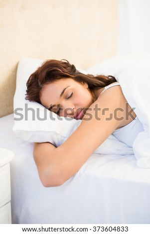Sleepy woman in her bed at home