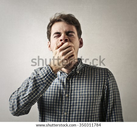 Sleepy young man - stock photo